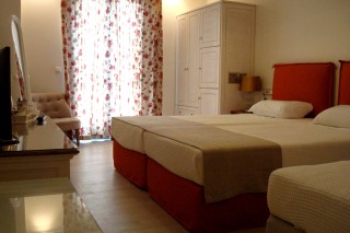 standard triple room alkyoni beach bed