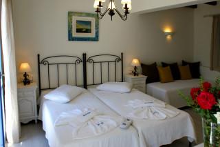 standard triple room alkyoni beach bedroom